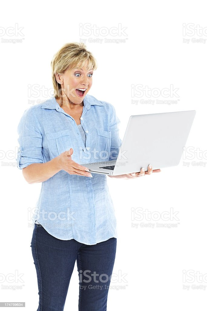 Excited middle aged woman looking at laptop computer royalty-free stock photo