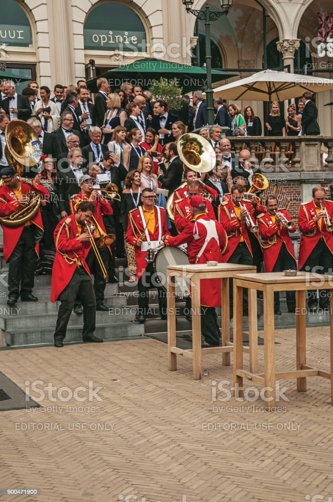 Excited musical band playing in outdoor festivity with cloudy sky at Amsterdam. stock photo