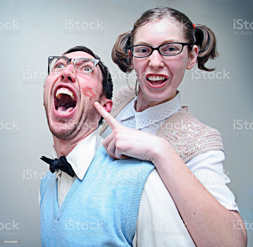 Excited Nerd Couple and Lip Kiss stock photo