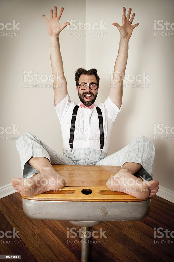 Excited Nerdy Man Sitting With Feet Up on School Desk royalty-free stock photo