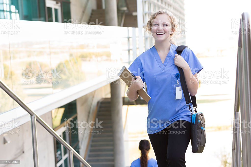 Excited nursing or medical student walking on college campus royalty-free stock photo
