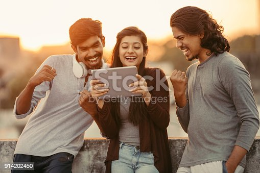 493712130 istock photo Excited of friends watching tv from tablet 914202450