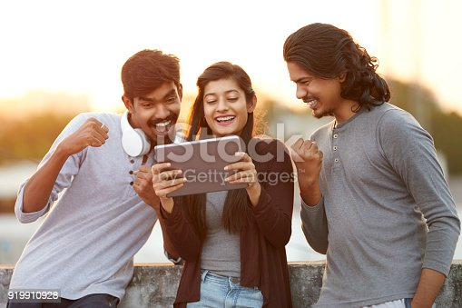 493712130 istock photo Excited of friends watching tv from tablet 919910928