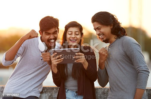 493712130 istock photo Excited of friends watching tv from tablet 919910932