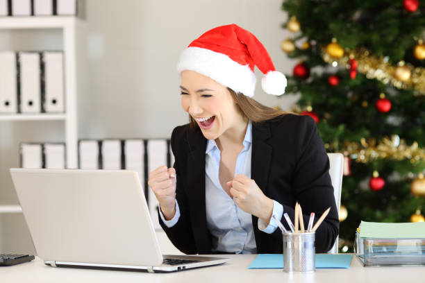 excited office worker receiving good news in christmas - bonus foto e immagini stock