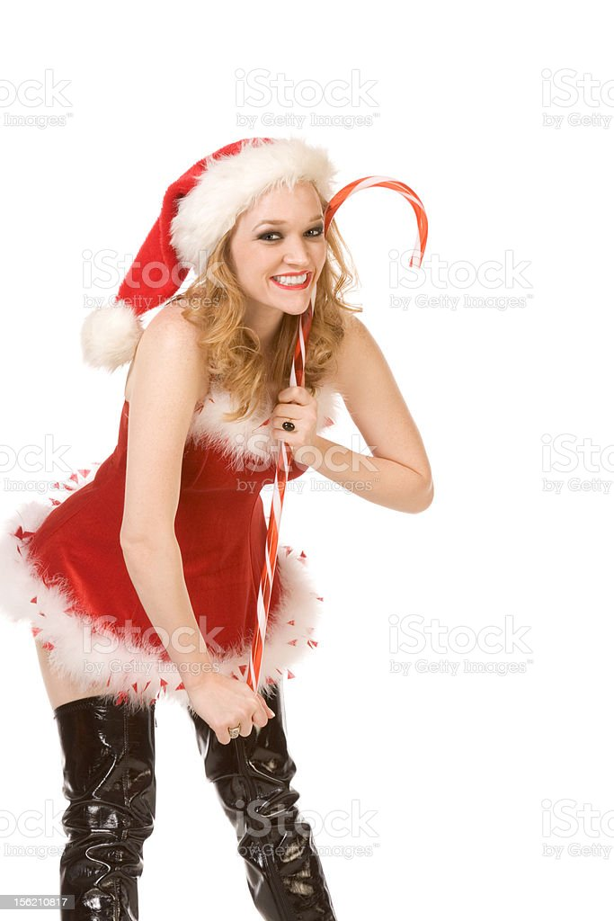 Excited pin up Mrs Santa Claus with huge candy cane royalty-free stock photo