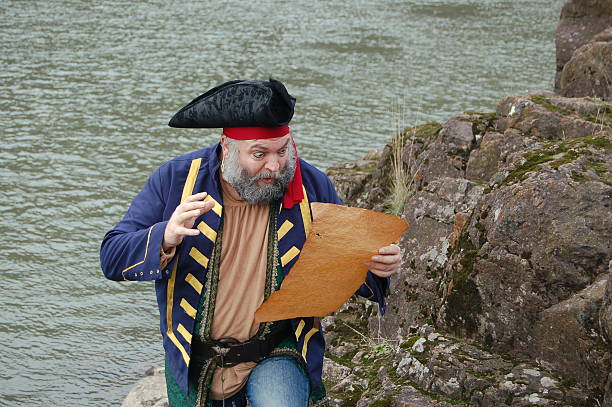 excited pirate with map - swashbuckler stock photos and pictures
