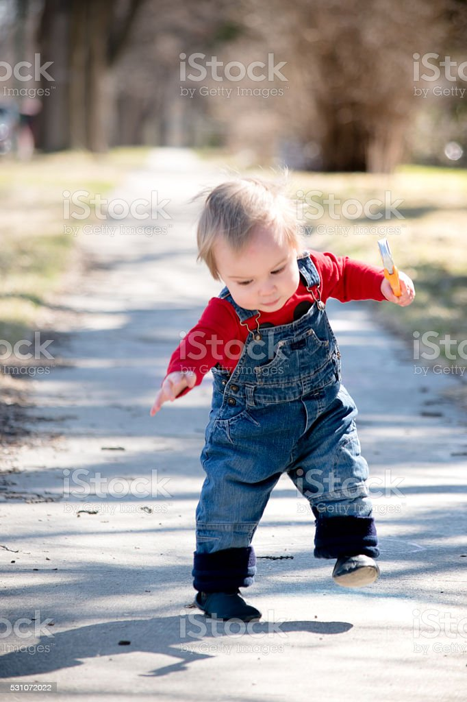 Excited plumber baby stock photo