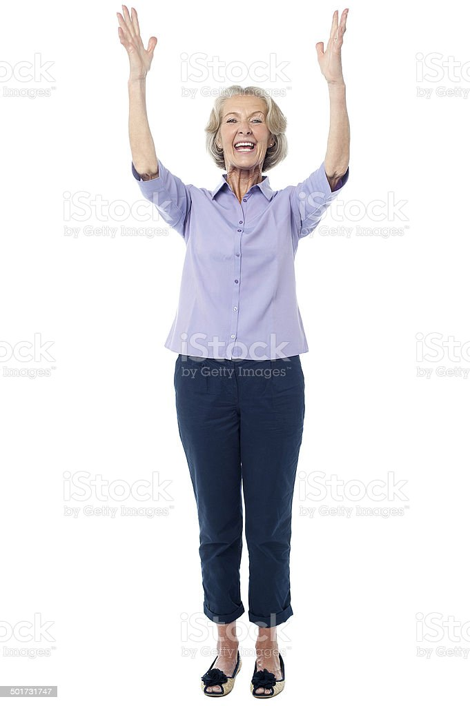 Excited pretty aged lady, full length shot. stock photo