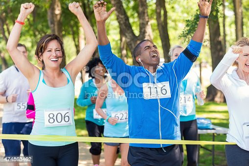 istock Excited runners celebrating as they win marathon or 5k race 474863462