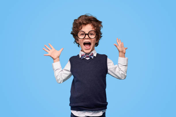Excited schoolboy screaming and gesturing with hands stock photo