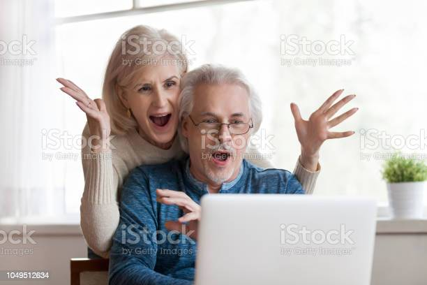 Excited senior couple looking at laptop surprised by good news picture id1049512634?b=1&k=6&m=1049512634&s=612x612&h=po6vf11wqmd7h3l2 o2a9jv4yctwpp0bcgwcm0qxbw0=