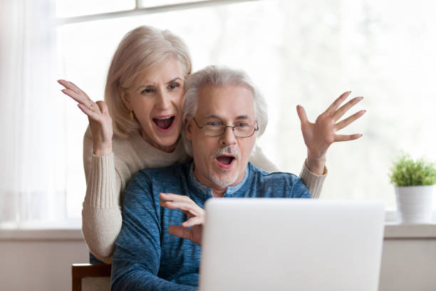 Excited senior couple looking at laptop surprised by good news picture id1049512634?b=1&k=6&m=1049512634&s=612x612&w=0&h=0zudhne0rjknnopv jrootaryuqv4ijg14gxhw6abbe=