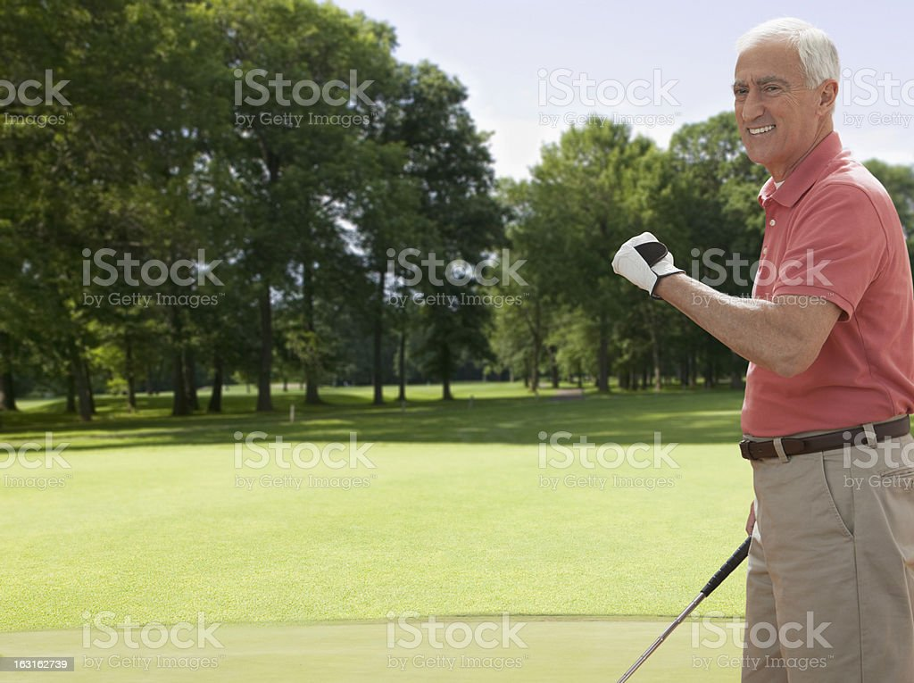 Excited senior man playing golf royalty-free stock photo
