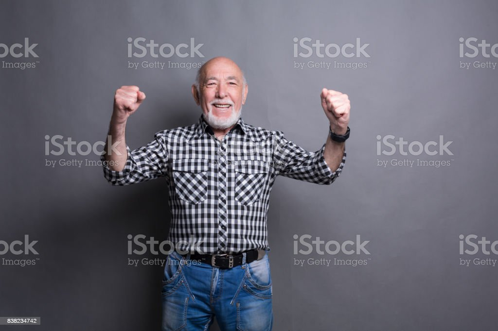 Excited senior man very glad to success stock photo