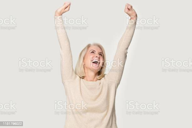 Excited senior woman raised stretched hands feels happy studio shot picture id1151796022?b=1&k=6&m=1151796022&s=612x612&h=du8726l1e2n1hp7pdhol dzdnjlgzxqjwax26rftmrm=