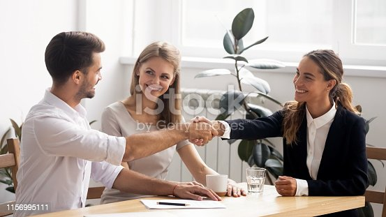 istock Excited smiling caucasian business people handshaking greet each other 1156995111