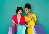 istock Excited smiling multiethnic girls with shopping bags 888147612