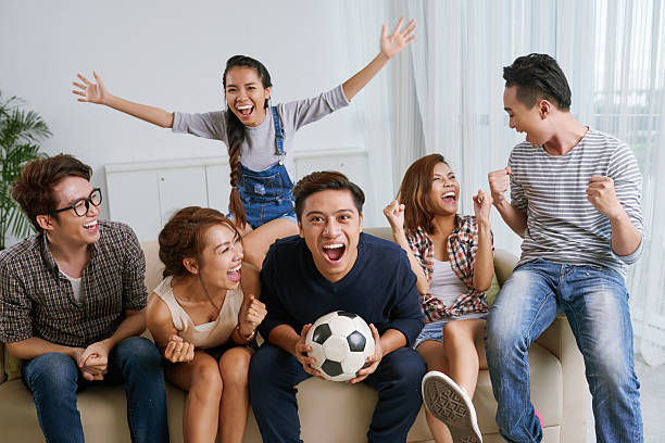 Excited soccer fans stock photo