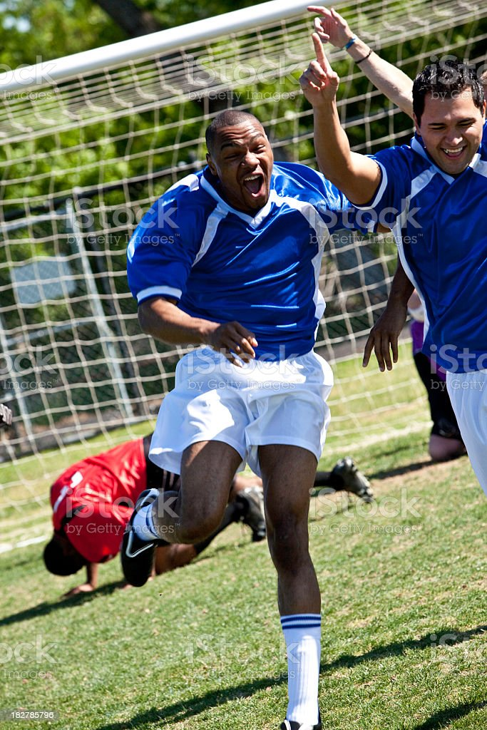 Excited Soccer Players Running After Scoring Goal royalty-free stock photo