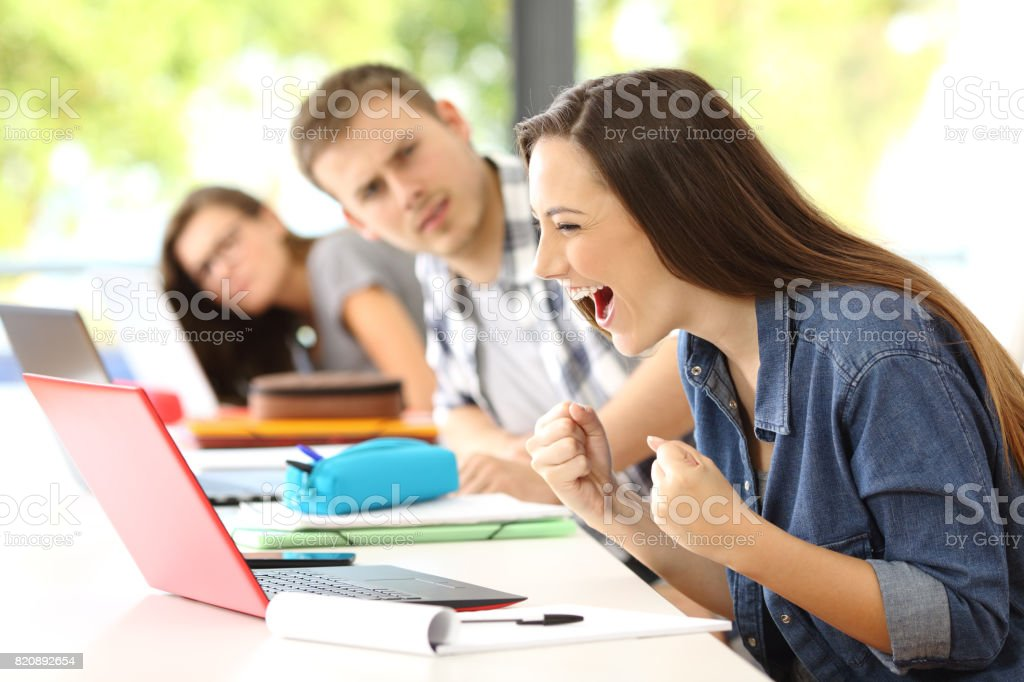Excited student on line in a classroom royalty-free stock photo