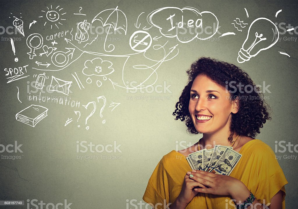 excited successful business woman holding money dollar bills stock photo