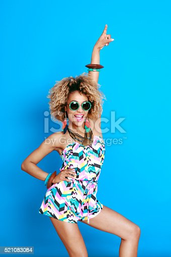 521083232istockphoto Excited summer afro young woman 521083084