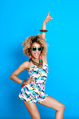 1062933270 istock photo Excited summer afro young woman 521083084