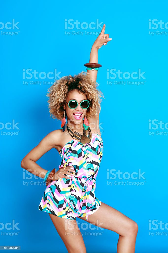 Excited summer afro young woman stock photo