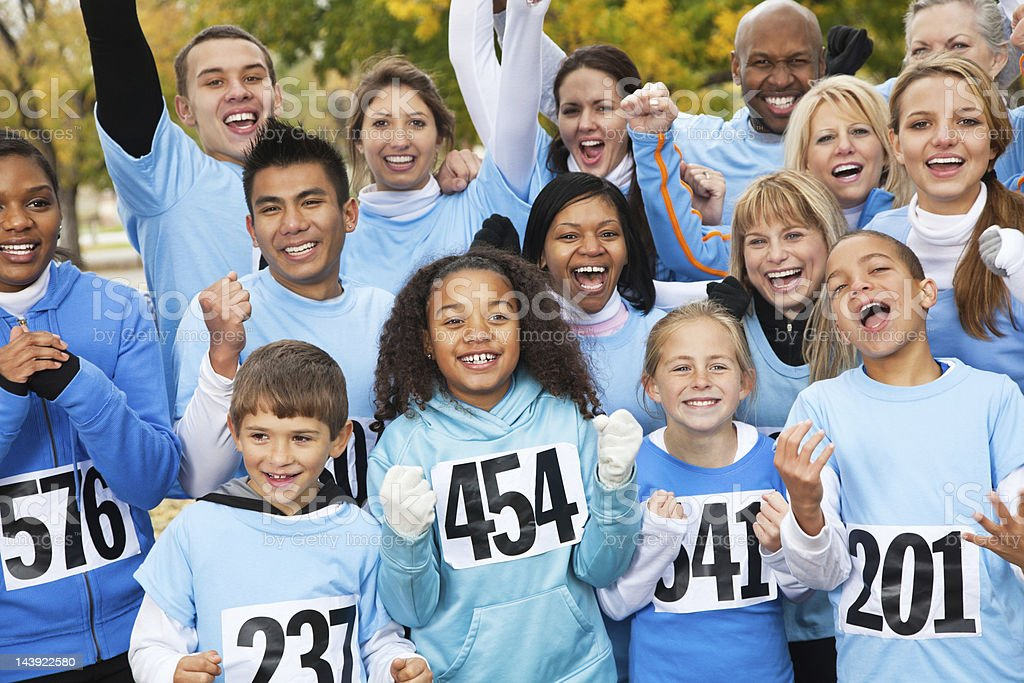 Excited team at a charity race stock photo