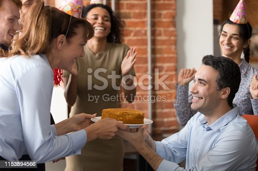 istock Excited team congratulate colleague in office making birthday present 1153894566