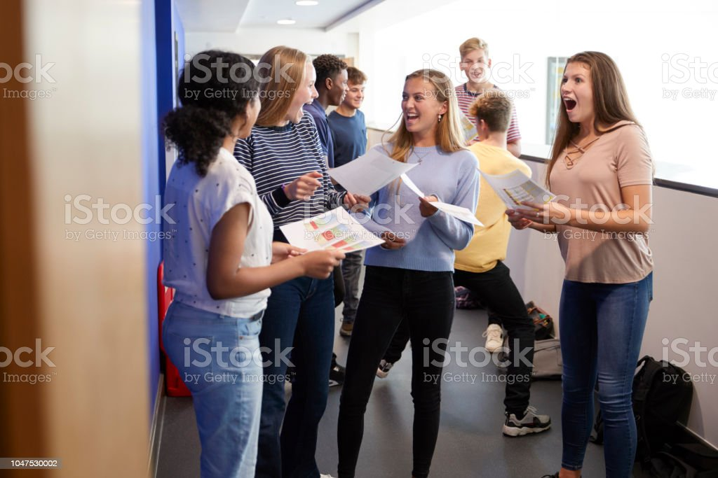 Excited Teenage High School Students Celebrating Exam Results In...