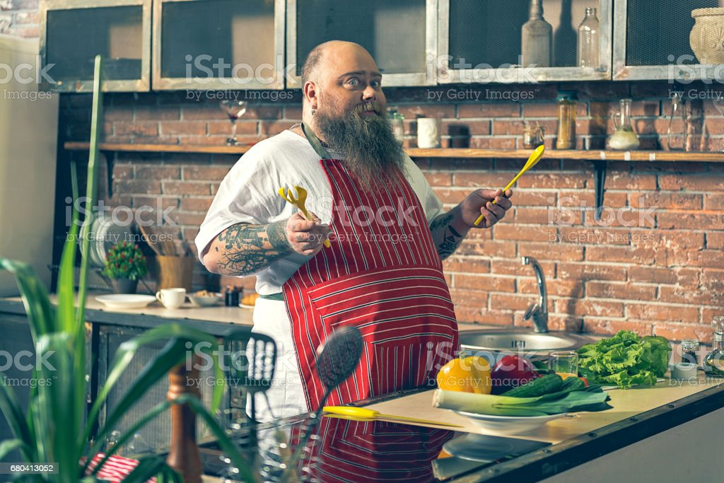 Excited thick guy preparing healthy breakfast stock photo