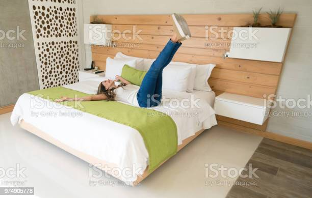 Excited traveling woman in her room at the hotel picture id974905778?b=1&k=6&m=974905778&s=612x612&h=vmgao5gd2cixckyvsgp n7my0kkyjzbqyhdgizwu0yi=