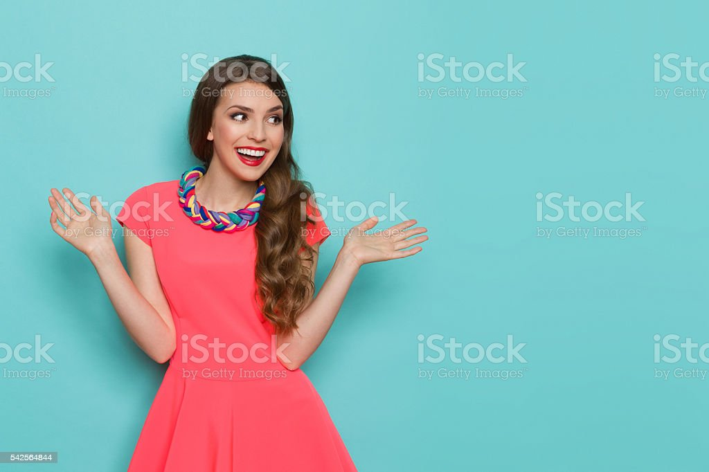Excited Vibrant Woman Looking Away stock photo