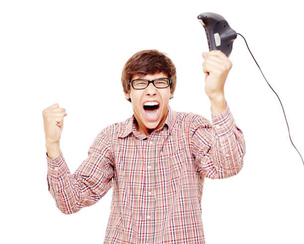 excited video gamer celebrating win - filmato foto e immagini stock