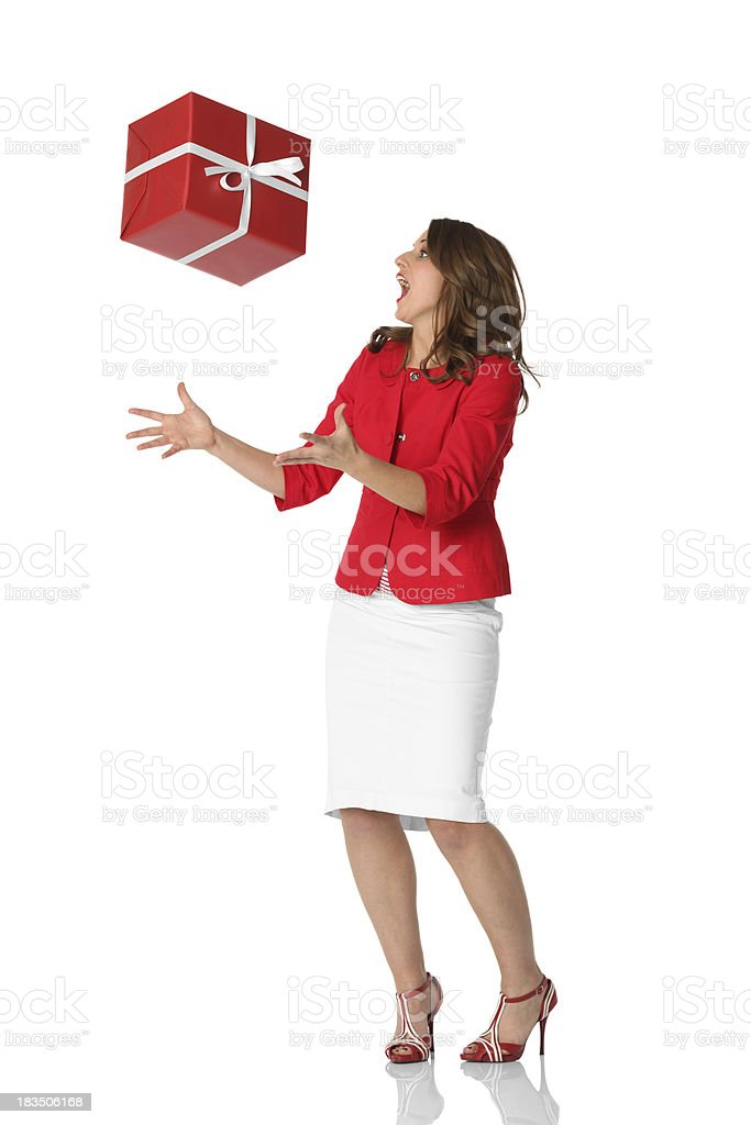Excited woman catching a present royalty-free stock photo