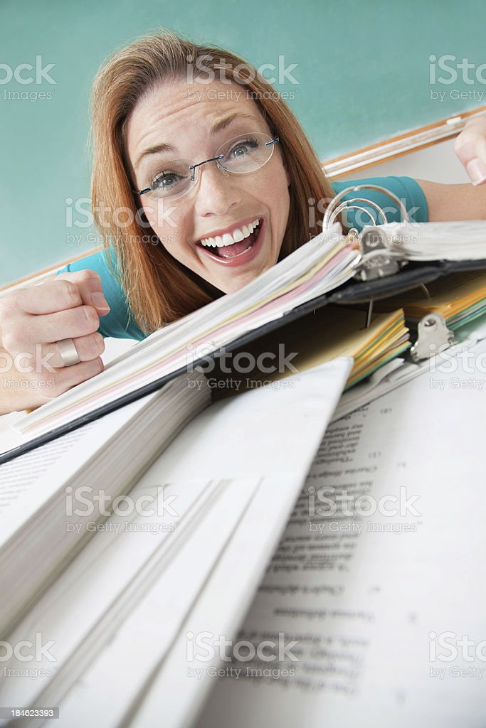 Excited woman conquering school work in classroom royalty-free stock photo