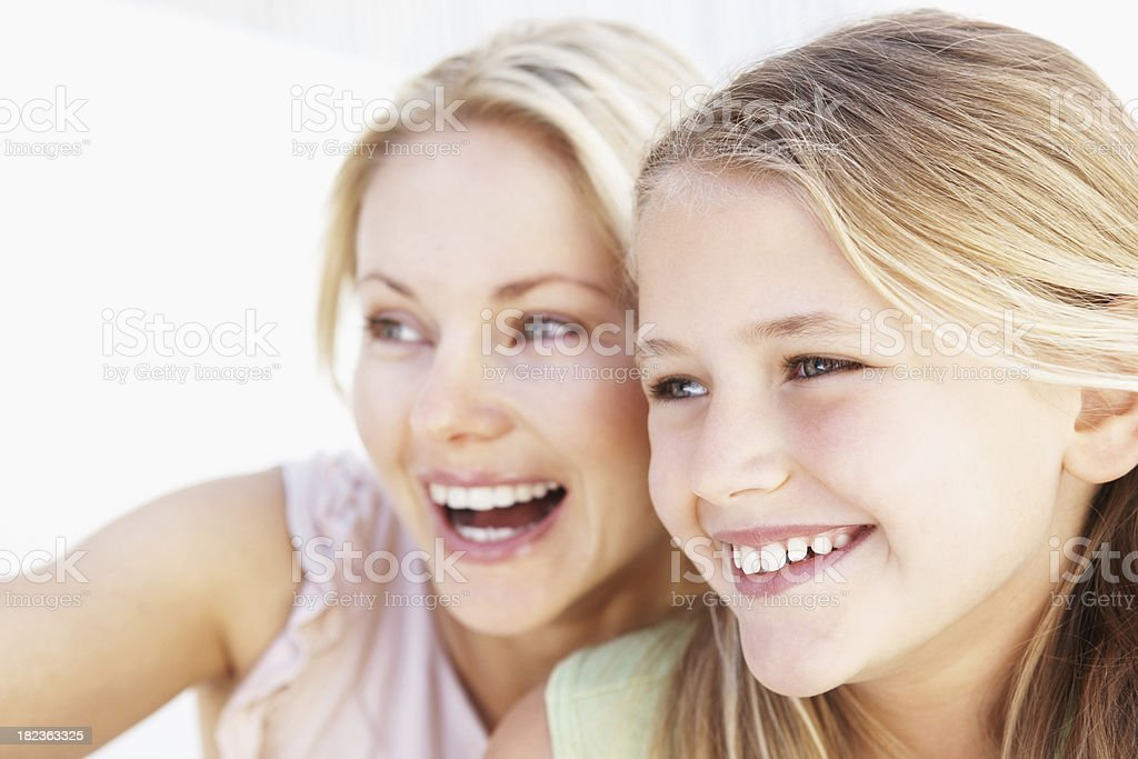 Excited woman enjoying with her daughter royalty-free stock photo
