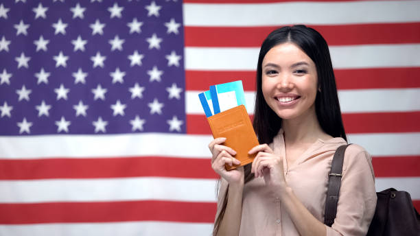 Excited woman holding passport and flight tickets against usa flag picture id1169983467?b=1&k=6&m=1169983467&s=612x612&w=0&h=ucqvse f5tsrzydfw5tcyjk67cxgescriyvalgr0hwc=