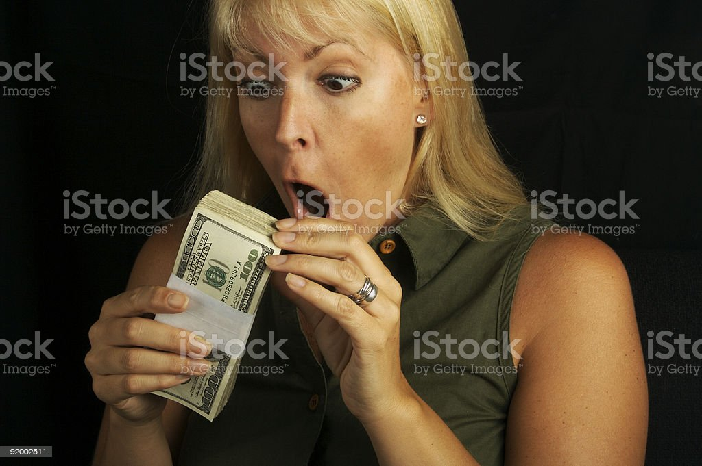 Excited Woman Holding Stack of Money royalty-free stock photo