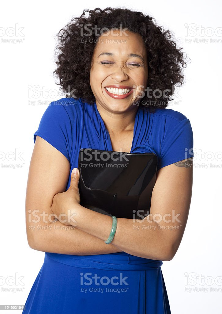 excited woman hugging her touch screen tablet royalty-free stock photo