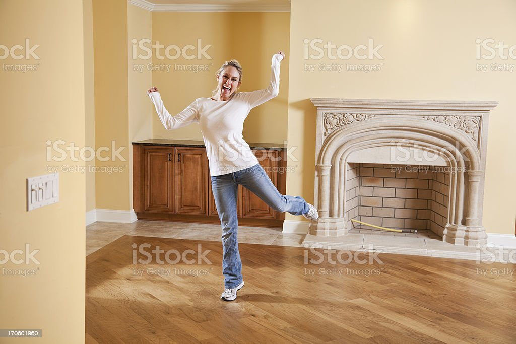 Excited woman in new house royalty-free stock photo