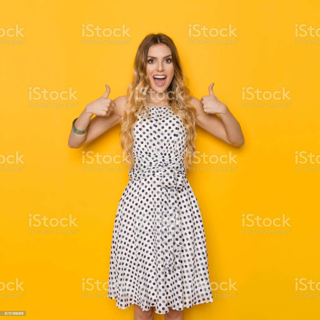Excited Woman Is Shouting And Showing Thumbs Up stock photo
