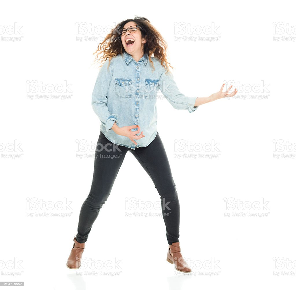 Excited woman playing air guitar stock photo