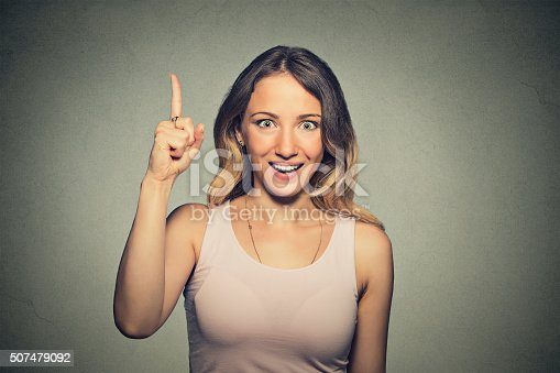 istock excited woman pointing with finger up 507479092