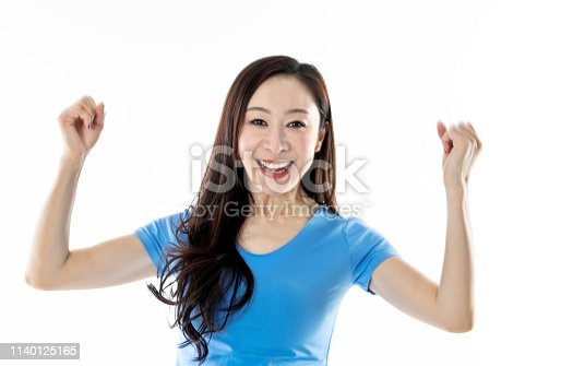 500150419istockphoto Excited woman raised fists on white background 1140125165