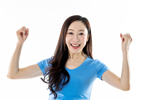 500150419 istock photo Excited woman raised fists on white background 1140125165