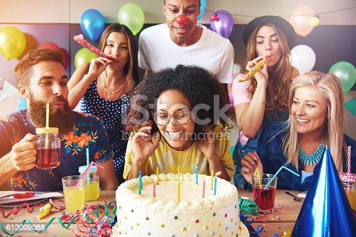 istock Excited woman ready to blow out candles 612009088