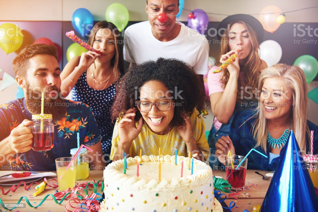 Excited woman ready to blow out candles stock photo